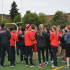 "The track team finishes its warm-up by clapping and yelling ""Cards!"" at a home meet against Aloha on April 16."