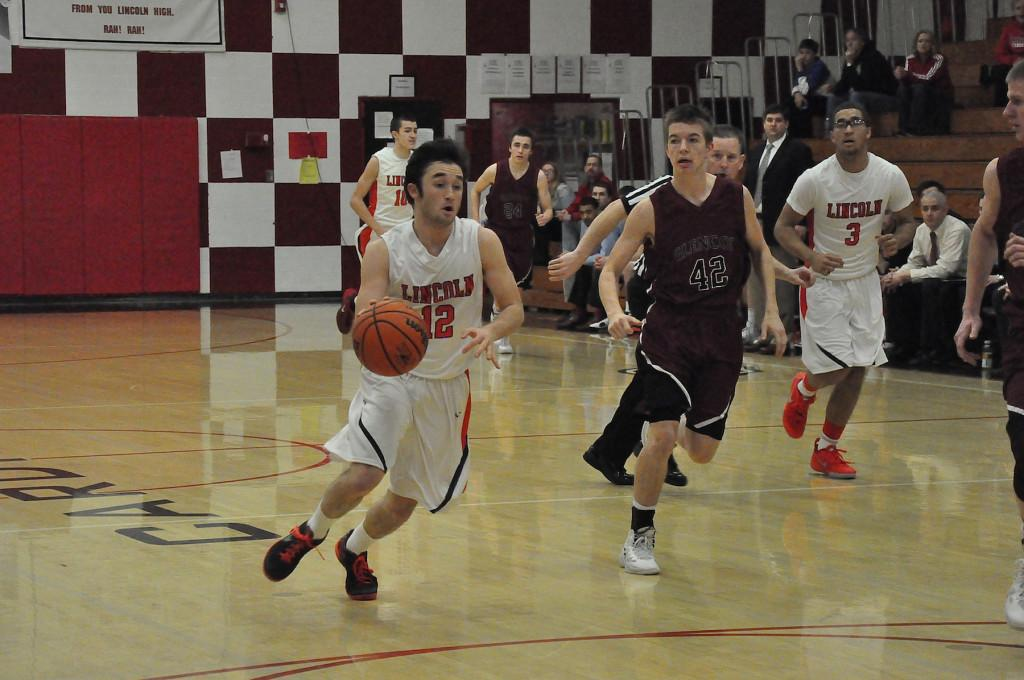 Matt Peeler drives to the hoop against a Glencoe opponent March 1. The Cardinals host Lake Oswego tonight at 7 p.m.