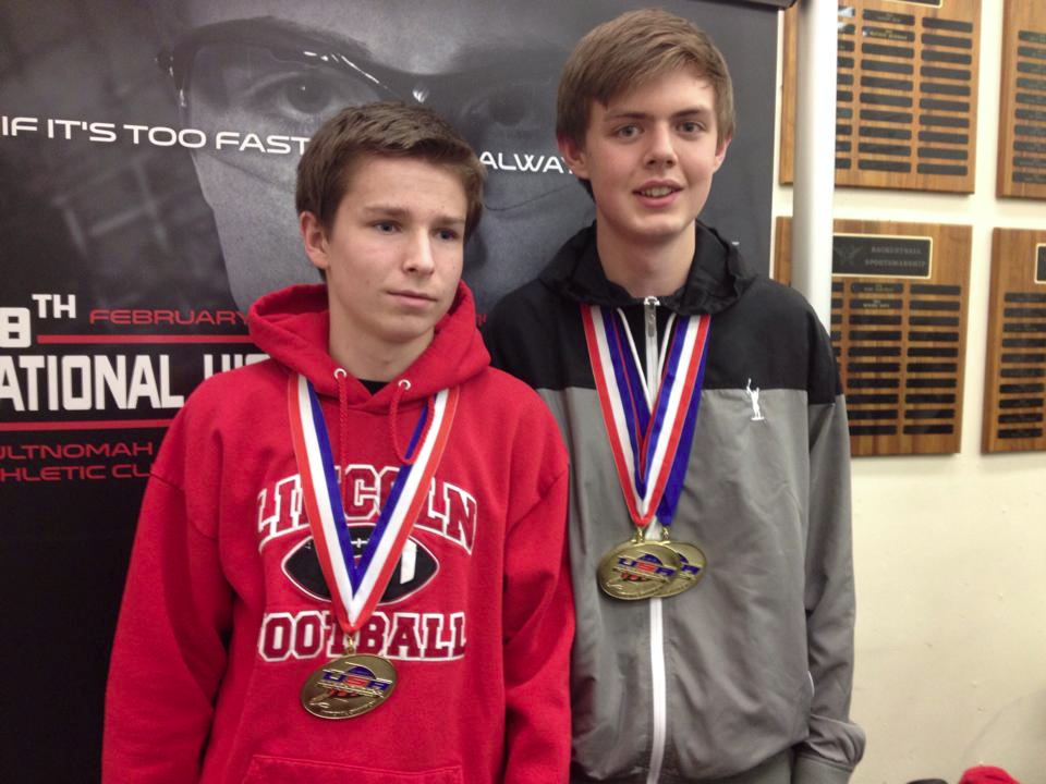 Will Hoge (left) and Gavin Usher display their national champion medals.