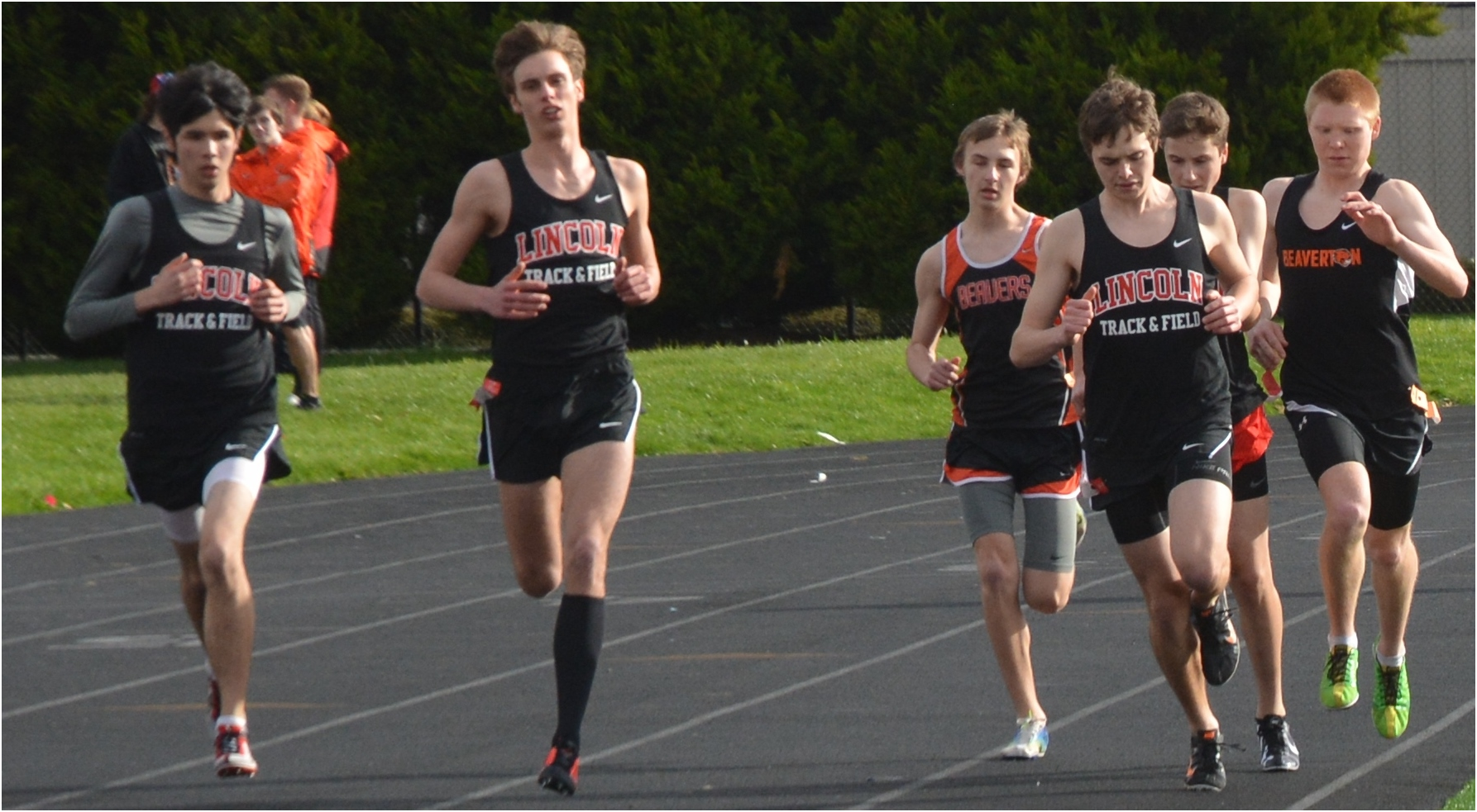 Jaxom Moore, Ransom Gravatt, and Teddy Kortenhoff take the lead in the 1500m run at Beaverton. Gravatt won the race in 4:15.68, and Graham was second in 4:18.68.