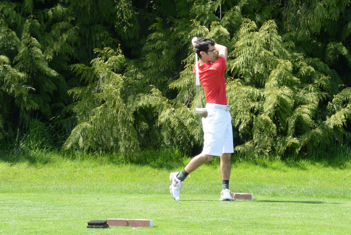 Varisty golfer Ben Stickney hits his tee shot on the first hole at the Langdon course.