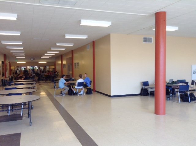 Students+casually+sit+in+the+new+cafeteria+during+a+free+period.