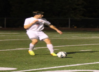 Senior defender Quin Gattey takes a free kick against Franklin.
