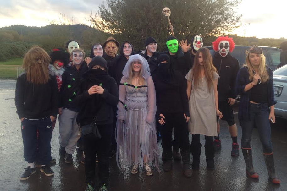 Snowboard and football team members gather in preparation to scare visitors to the corn maze at Kruger Farm Oct. 26.