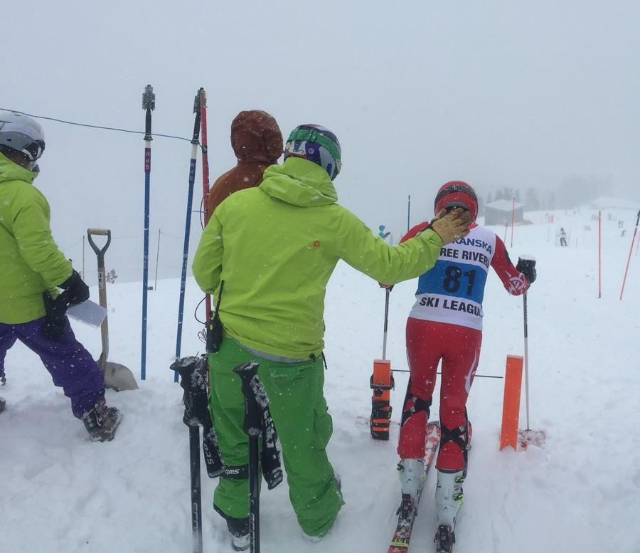 Coach Robin Chapin holds on to Asa Miller before Miller begins a slalom run at Mt. Hood Meadows Jan. 24.
