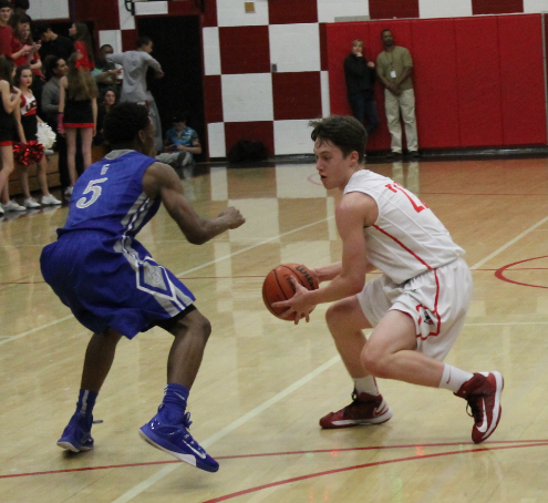 Senior Trent Callan fakes out a Grant defender as the Cardinals beat the Generals 49-34 in the final home game Feb. 20.