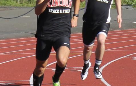 Josiah Langstaff leads the run while  Gabe Sullivan trails shortly. (both senior).