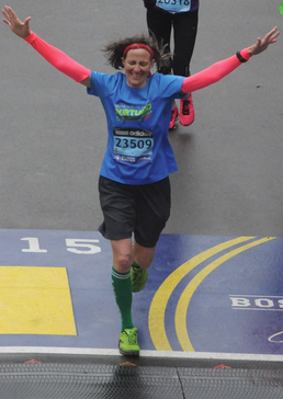 Maureen Kenny crosses the finish line of the Boston Marathon in three hours and 49 minutes.  Photo by Marathon Photo
