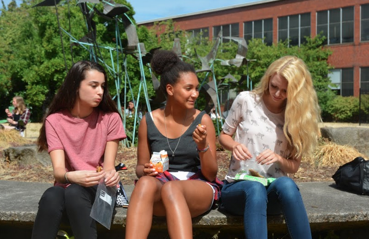 Junior Sofia McLeod-Ali (center) chats with friends during lunch.