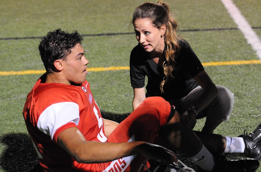 Athletic+Trainer+Jessica+Martschinske+helps+senior+Max+Hilligoss+with+a+leg+injury+during+a+game+against+Southridge.