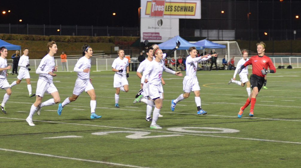 The team circles the field in celebration after a goal from junior Carson Graham.
