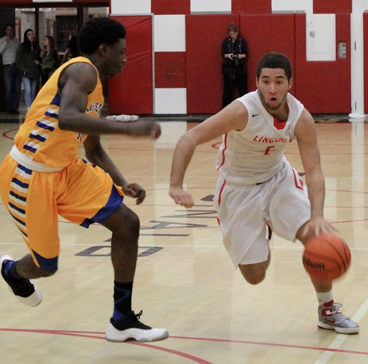 Junior Jonah Pemberton drives in towards the basket in a game against Jefferson.
