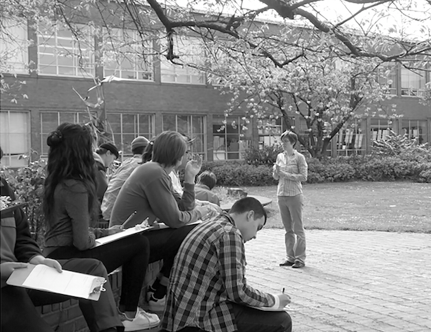 Laura+Armstrong+teaches+her+gardening+class+in+the+courtyard+on+an+early+spring+day.