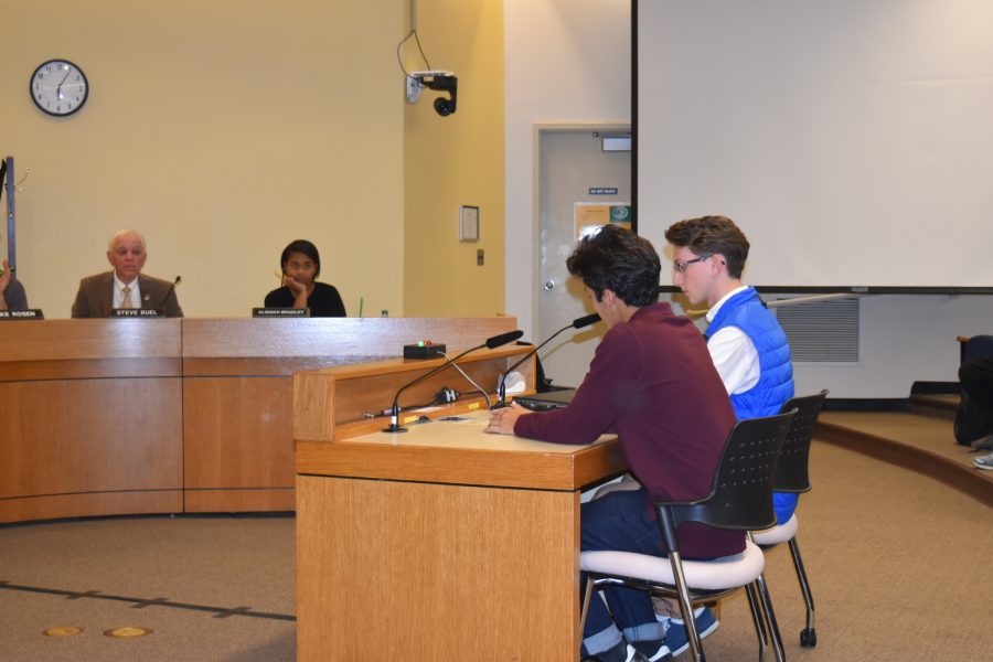 Seniors+Riley+Wilson+%28left%29+and+Michael+Ioffe+refuse+to+leave+the+podium+until+the+board+holds+another+public+meeting+to+discuss+a+November+bond.
