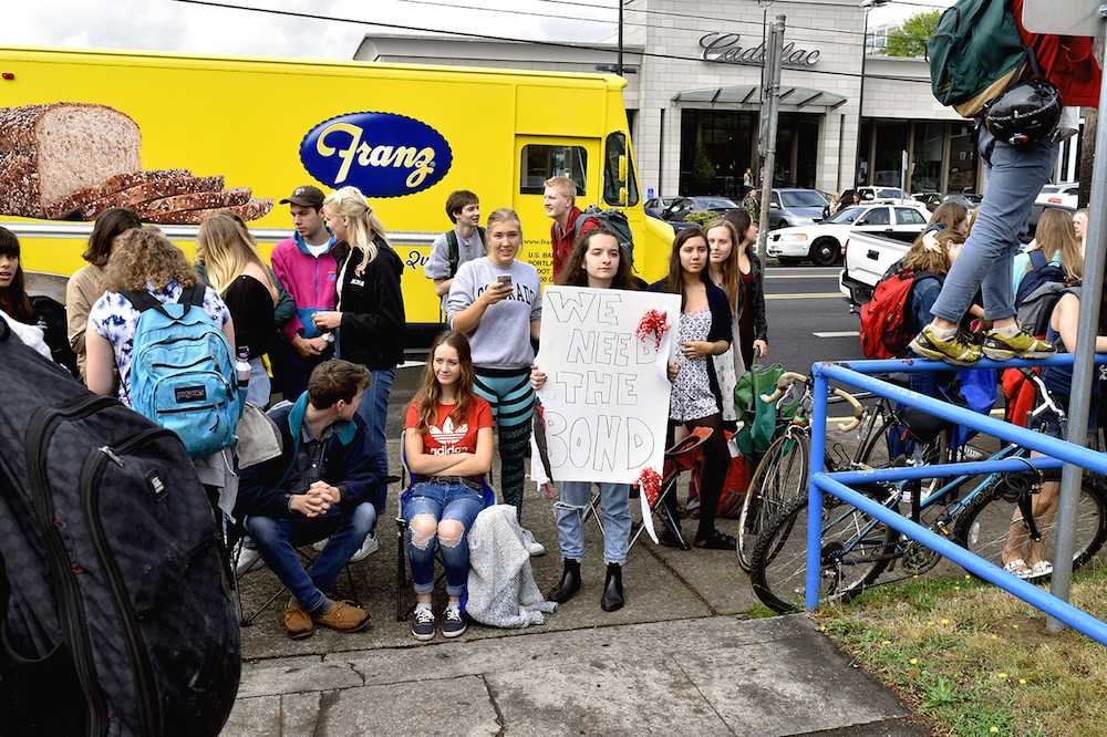 Lincoln students protest a police line at Benson's doors during their walkout on Sept. 7.