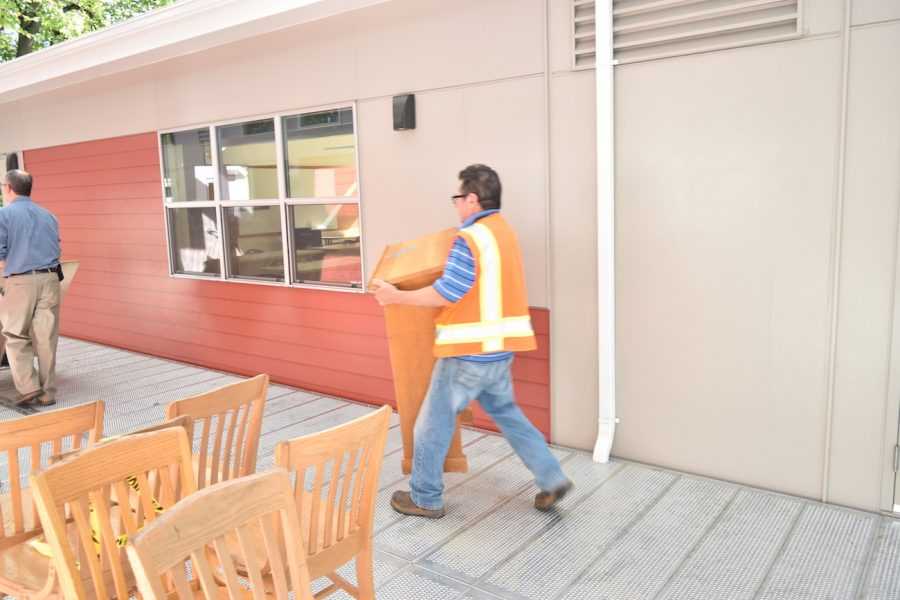 Staff bring furniture into the portables on the day of their opening Sept. 27. By Daniel Lewinsohn