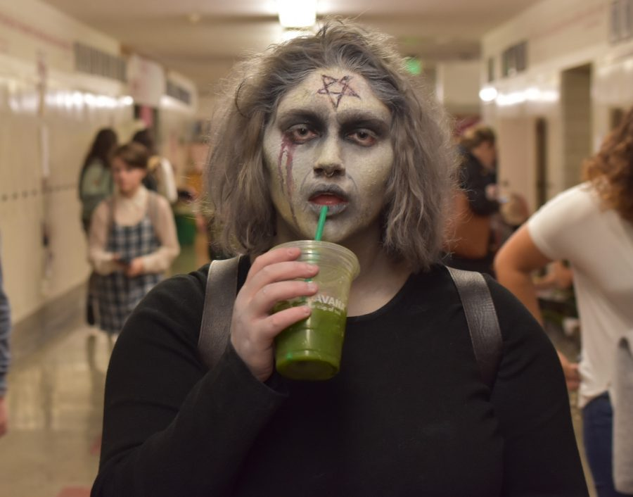 Some students went all out on their Halloween costume for spooky effect, and the green drink adds to the impression.