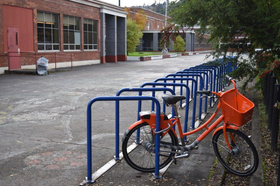 A Biketown bike sits on the rack outside Lincoln.