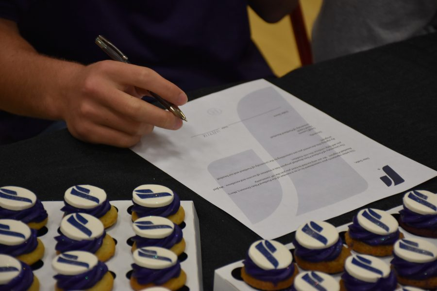 Gabe Skoro signs his letter of intent to attend University of Portland.