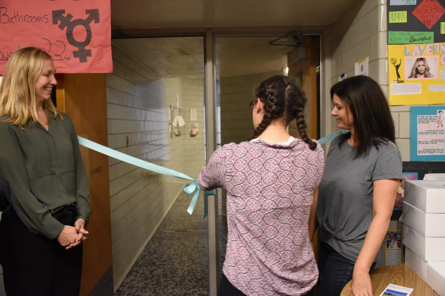 Leah Burian cuts the ribbon to open the gender-neutral restroom as principal Peyton Chapman (left) looks on on Nov. 22, 2016.