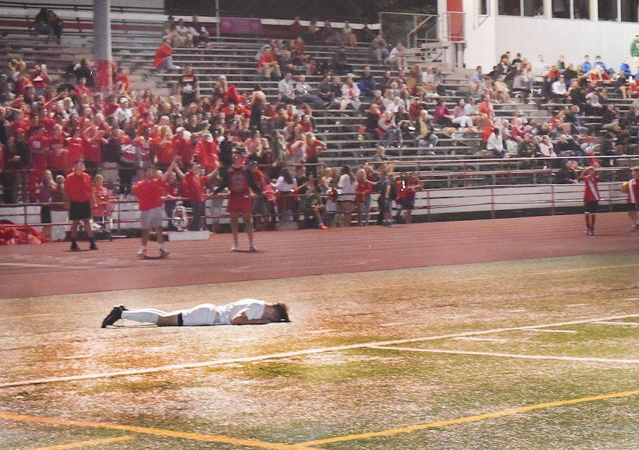 Senior Carson Graham lies on the ground during the Crosstown Clash, a 2-0 loss to Grant.