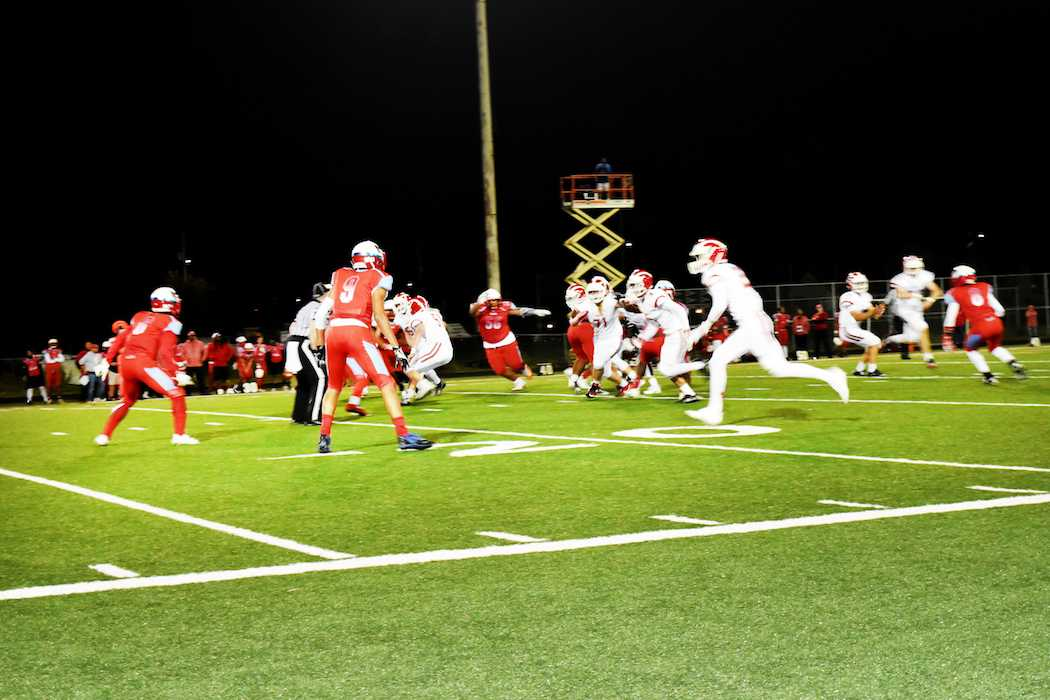 The Lincoln football team plays against Madison last October.