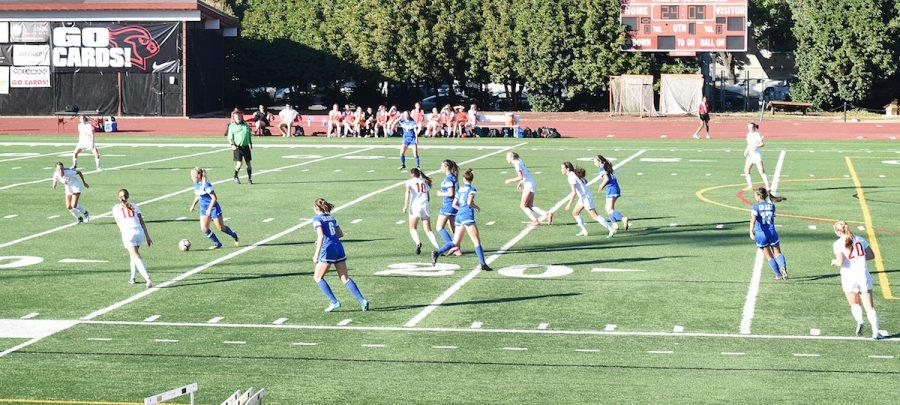 The varsity girls' soccer team plays Grant on Oct. 15. The team won the PIL, but fell in the second round of the playoffs.