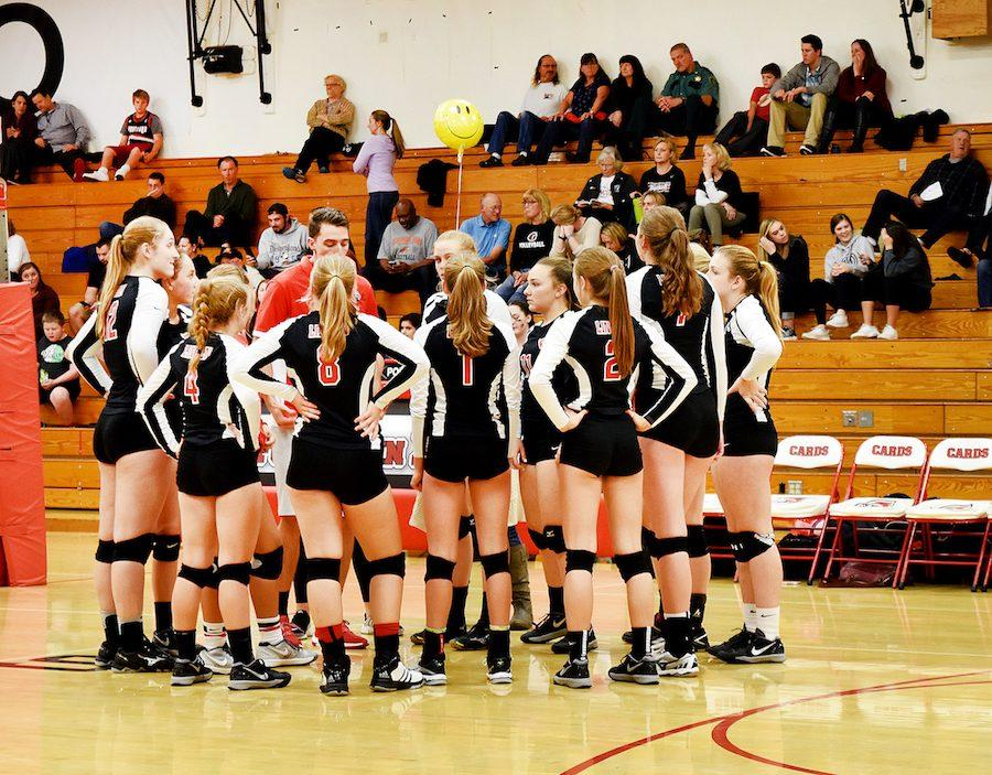 The+volleyball+team+huddles+during+the+final+game+of+the+season%2C+a+3-2+loss+to+Glencoe+in+the+first+round+of+the+playoffs.