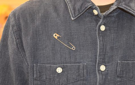 Some students have started wearing safety pins to show that they are safe people to talk to about the divisive issues that dominated this year's presidential campaign.
