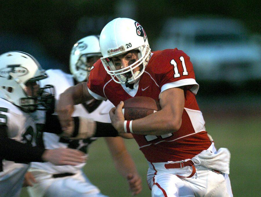 Connor+Kavanaugh%2C+class+of+2007%2C+evades+a+tackle+against+the+Tigard+Tigers+on+Sept.+8%2C+2006.+