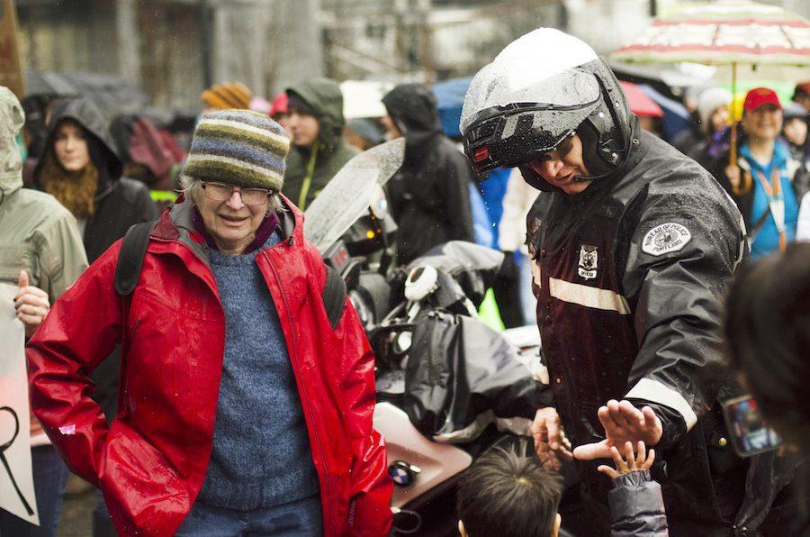 A Portland Police officer high-fives a young marcher at the Portland Women's March Jan. 21.