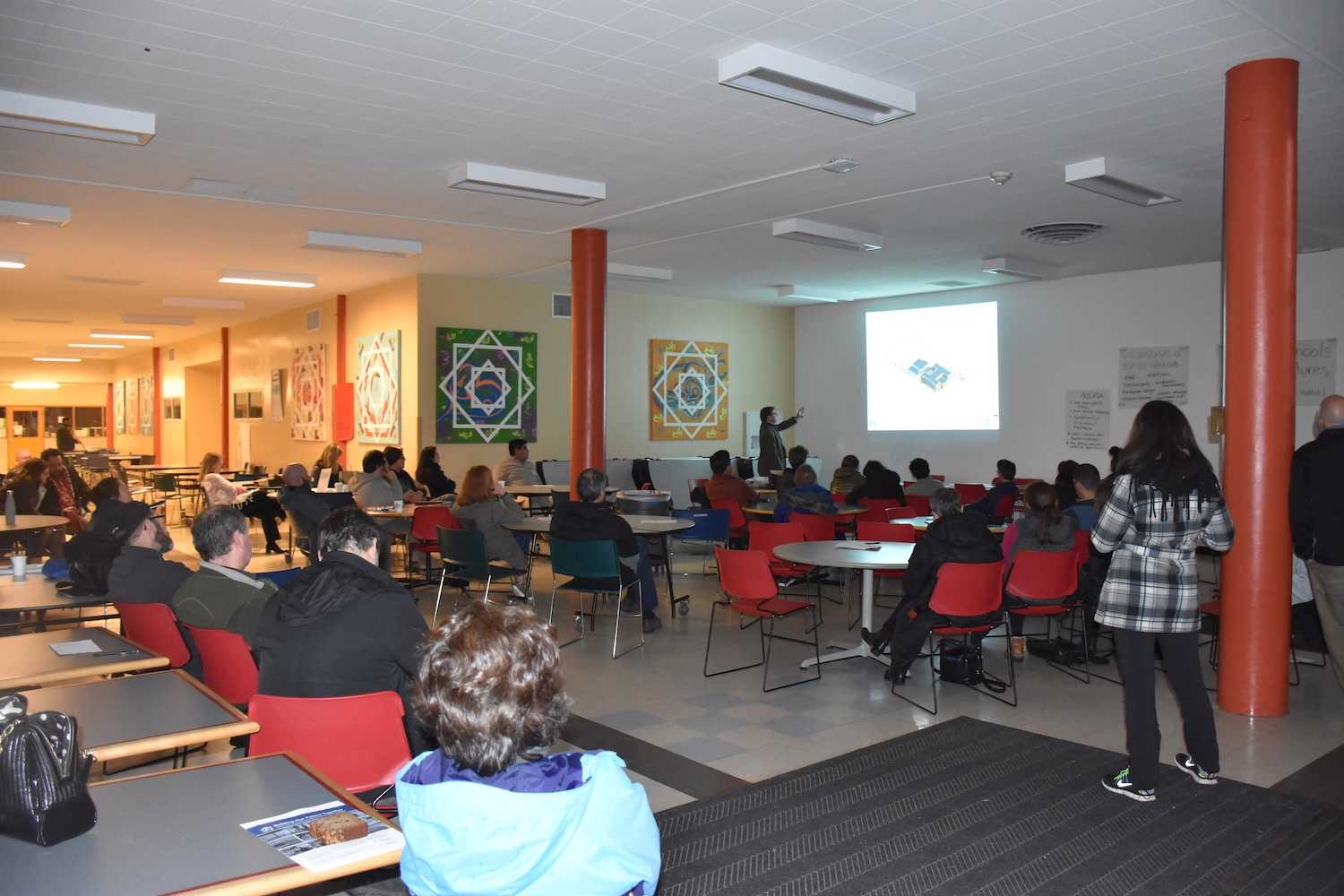 Community members gather in the cafeteria on Feb. 8 to discuss the upcoming school bond.