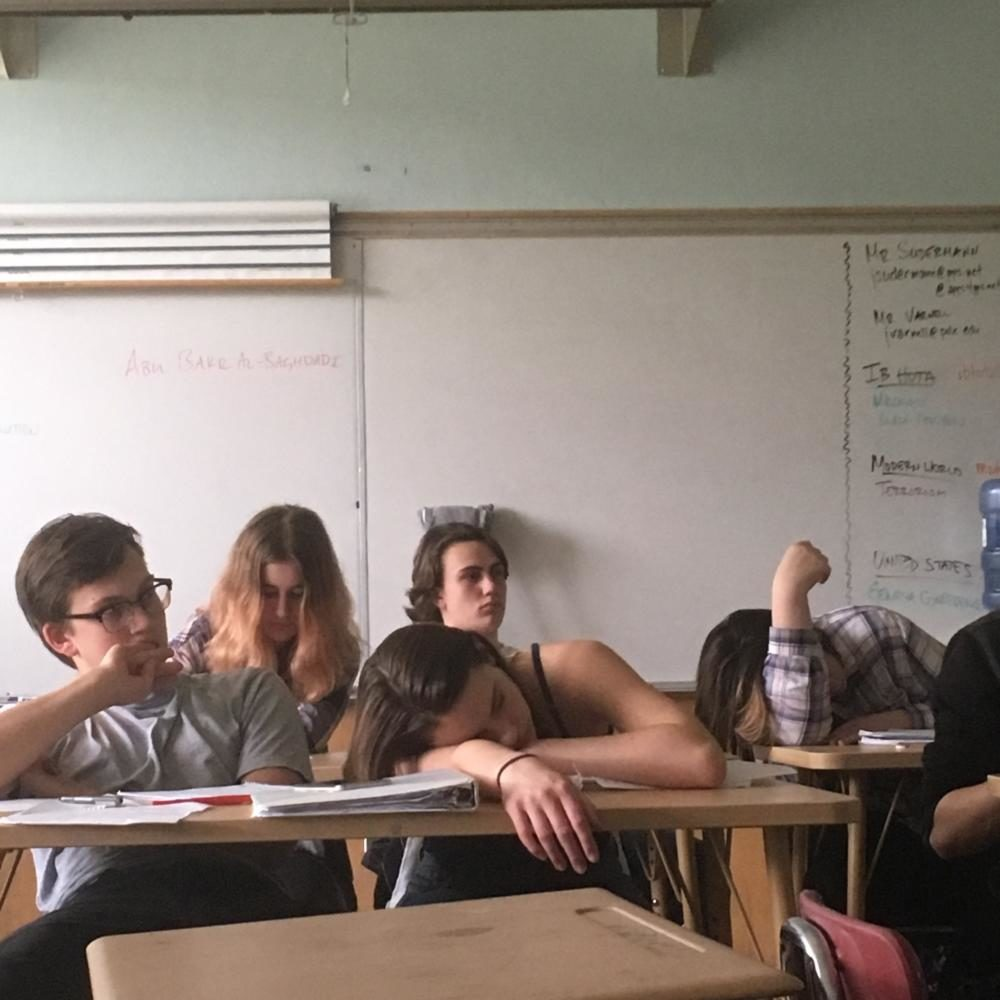 Sophomore Teal Scheffler (center) dozes off in class on April 19. Fatigue is a common issue in Lincoln classrooms and often results from sports.