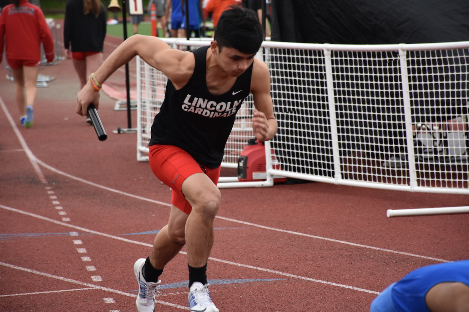 Sophomore Andre Gonzales runs at the PIL Meet at Lincoln on April 12, 2017.