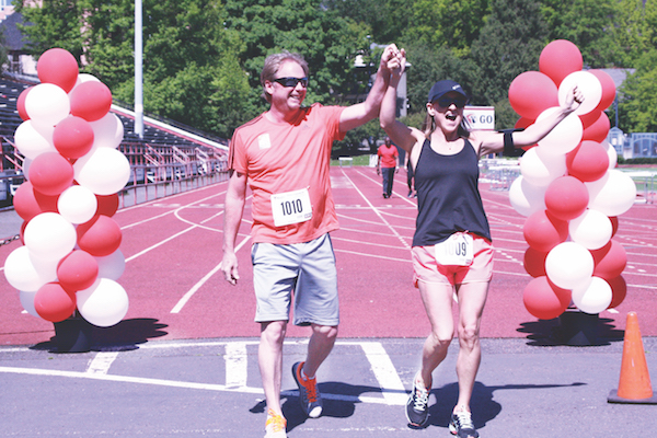 "Runners celebrate after completing the  rst annual ""Five 2 Thrive"" at Lincoln on May 21. The event raised more than $2,000 for the mental health program at Lincoln."