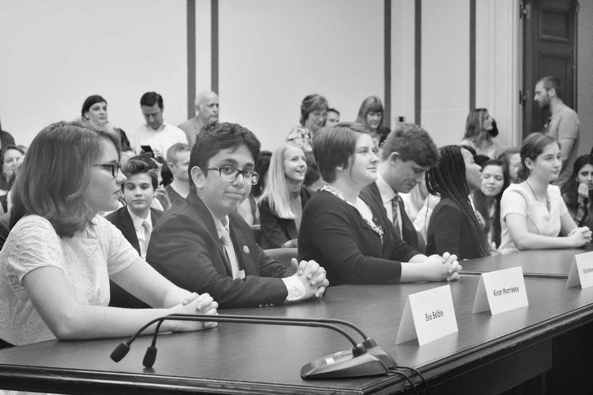 """Junior Kiran Morrissey (second from left, facing camera) prepares to compete at Nationals in Washington, D.C. in April 2016. He says of Con Team, """"the tradeoffs were worth the sacrifices."""""""