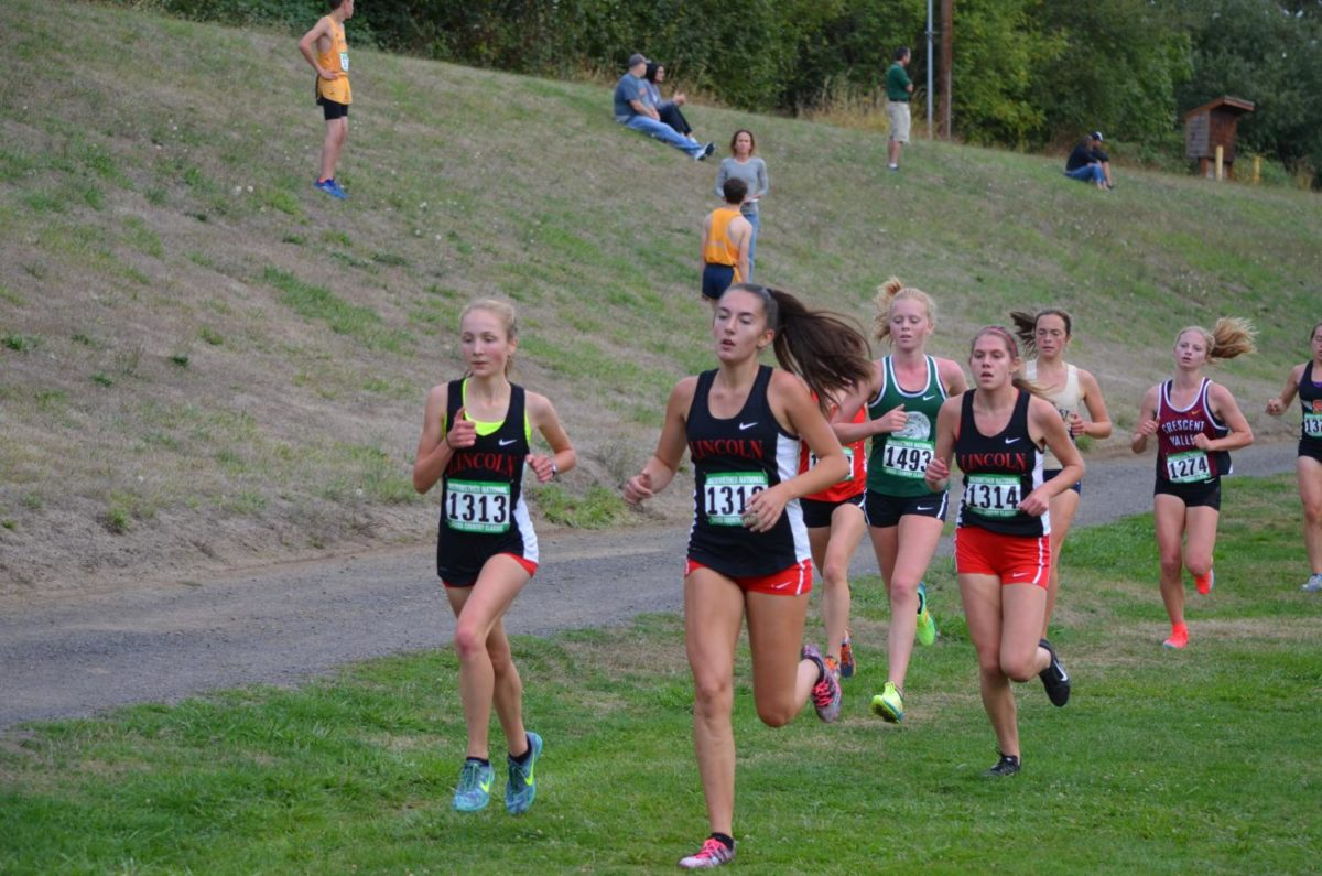 Cross+Country%0ALincoln+runners+%28from+left+to+right%29+sophomore+Maddie+Dolich%2C+junior+Kendall+Accetta+and+senior+Ellie+Kobak+run+at+the+Meriwether+National+Cross+Country+Classic+on+Sept.+22.+Lincoln+took++rst+place+at+the+meet.+Photo+courtesy+RICH+MEYER