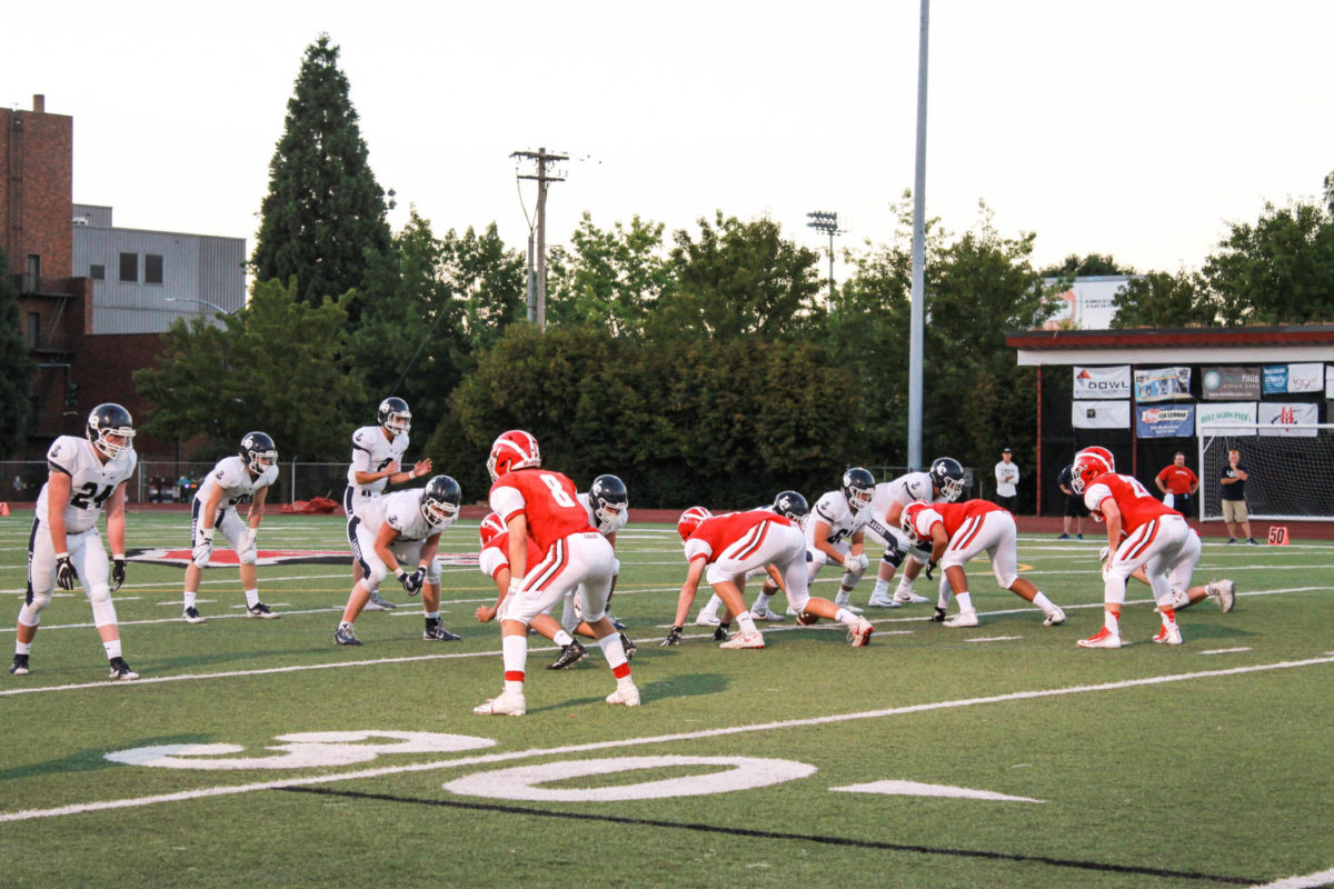 Football (2-2, league 2-0) The Cards' defense lines up during a 45-0 loss to Lake Oswego in the team's  first home game Sept. 8.