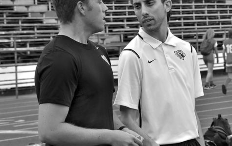Spanish teacher Pablo Dipascuale, who has taken over as head boys' soccer coach, speaks to assistance Stefan Viragh during practice