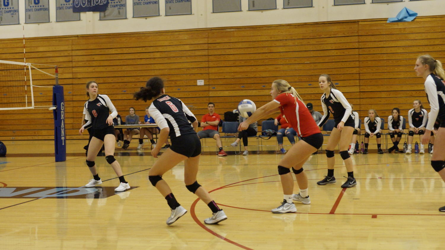 Junior Grace Zilbert (center) plays a ball during a 3-1 victory at Grant on Oct. 11.