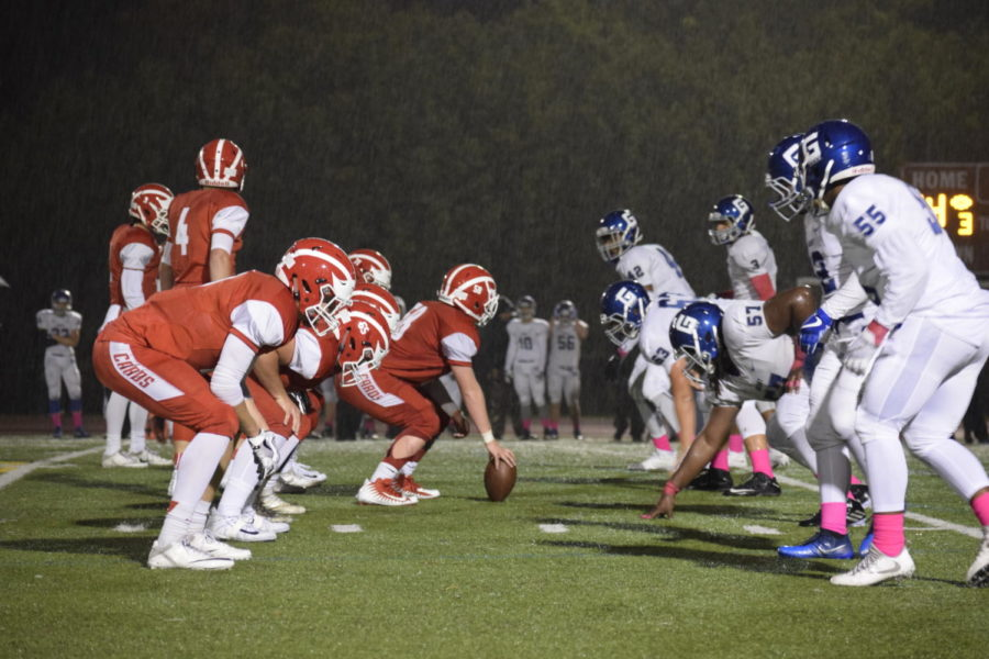 The football team plays during a 35-28 victory over rival Grant on a rainy night Oct. 20.