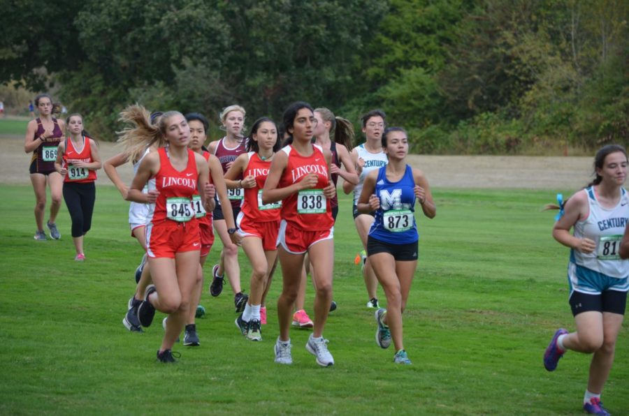 The XC team competes at the Meriwether Classic on Sep. 22. Photo by Rich Meyer.