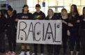 Dozens of students kneel in mass protest