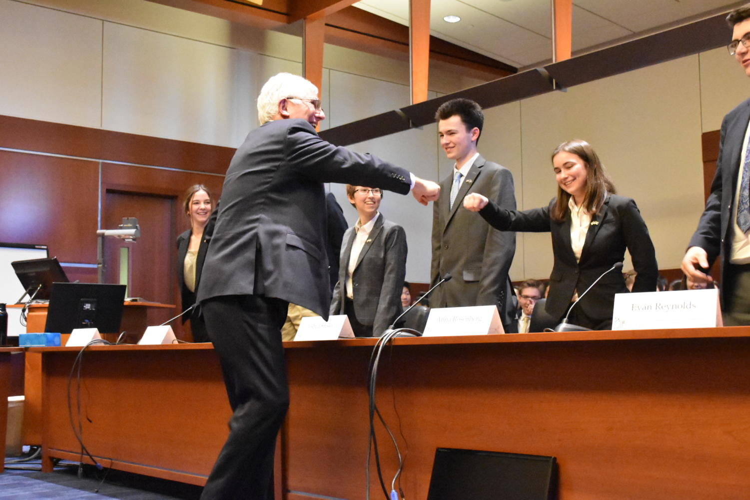One of the judges (left) at the We the People state competition fist bumps sophomore Anna Rosenberg  after the Unit Six hearing. Lincoln placed second in the state.