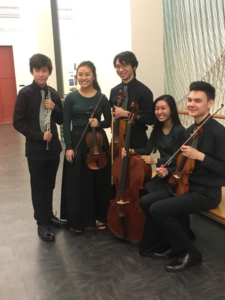 Freshman Elliot Shin (left) poses after a recent oboe performance. Shin is organizing a concert in Korea's demilitarized zone to promote peace between North and South Korea.