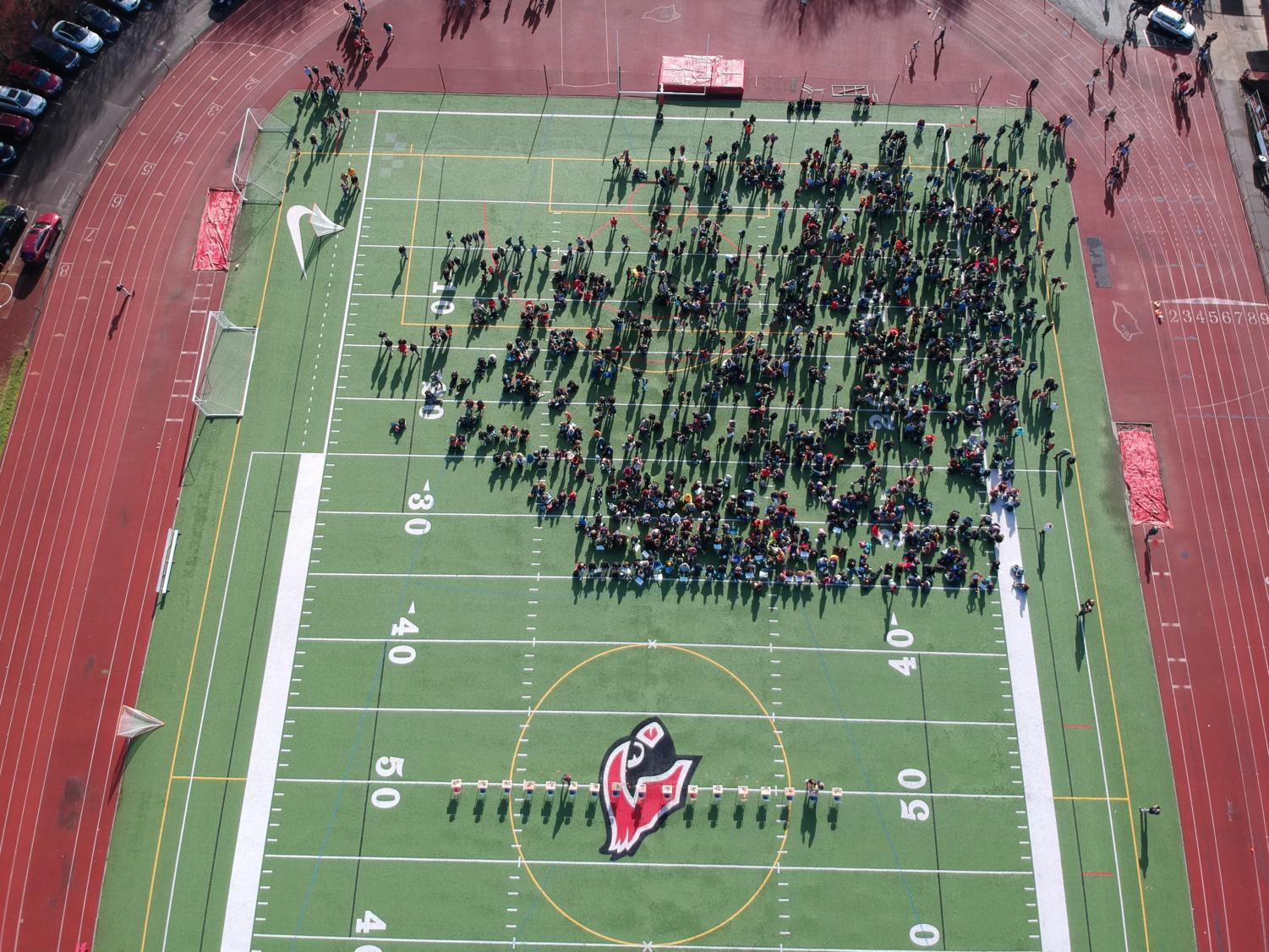 Students gather on the field to pay respect for the 17 students who lost their lives in Parkland, Florida on March 14.