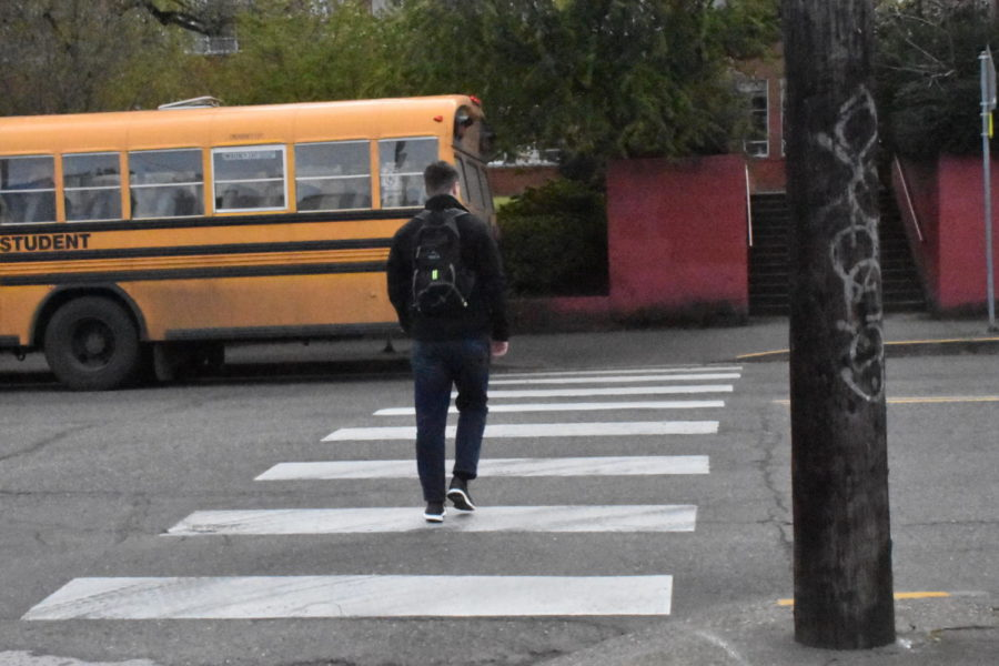 Student walks across Salmon street at 15th.