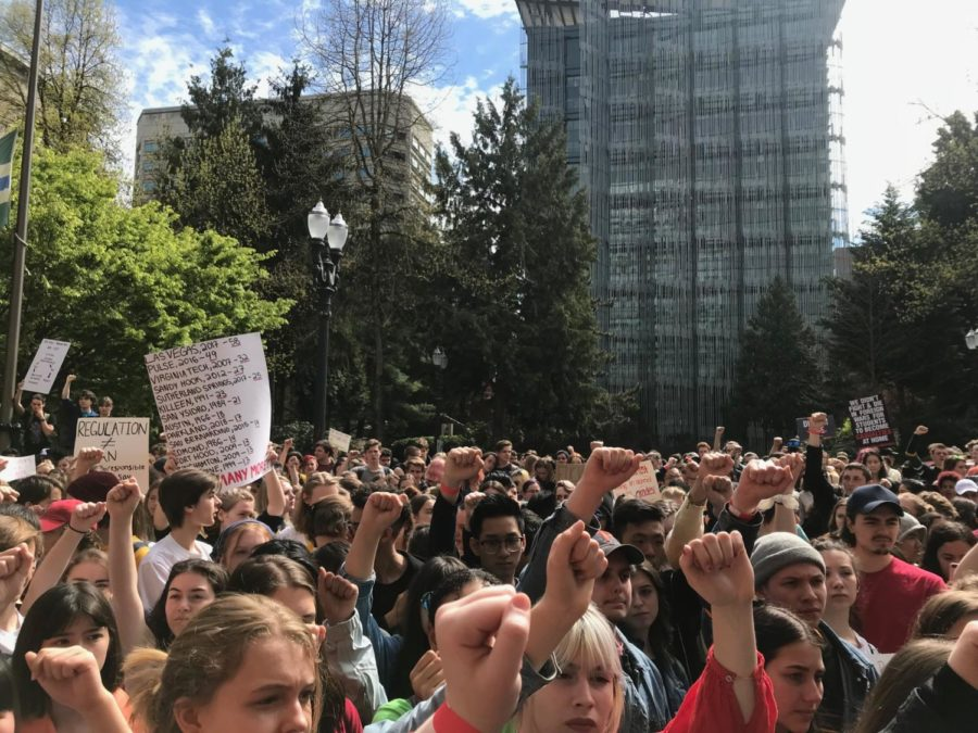 Protesting students raise their fists in frustration during the rally at Portland City Hall. They called for action to make schools safer.