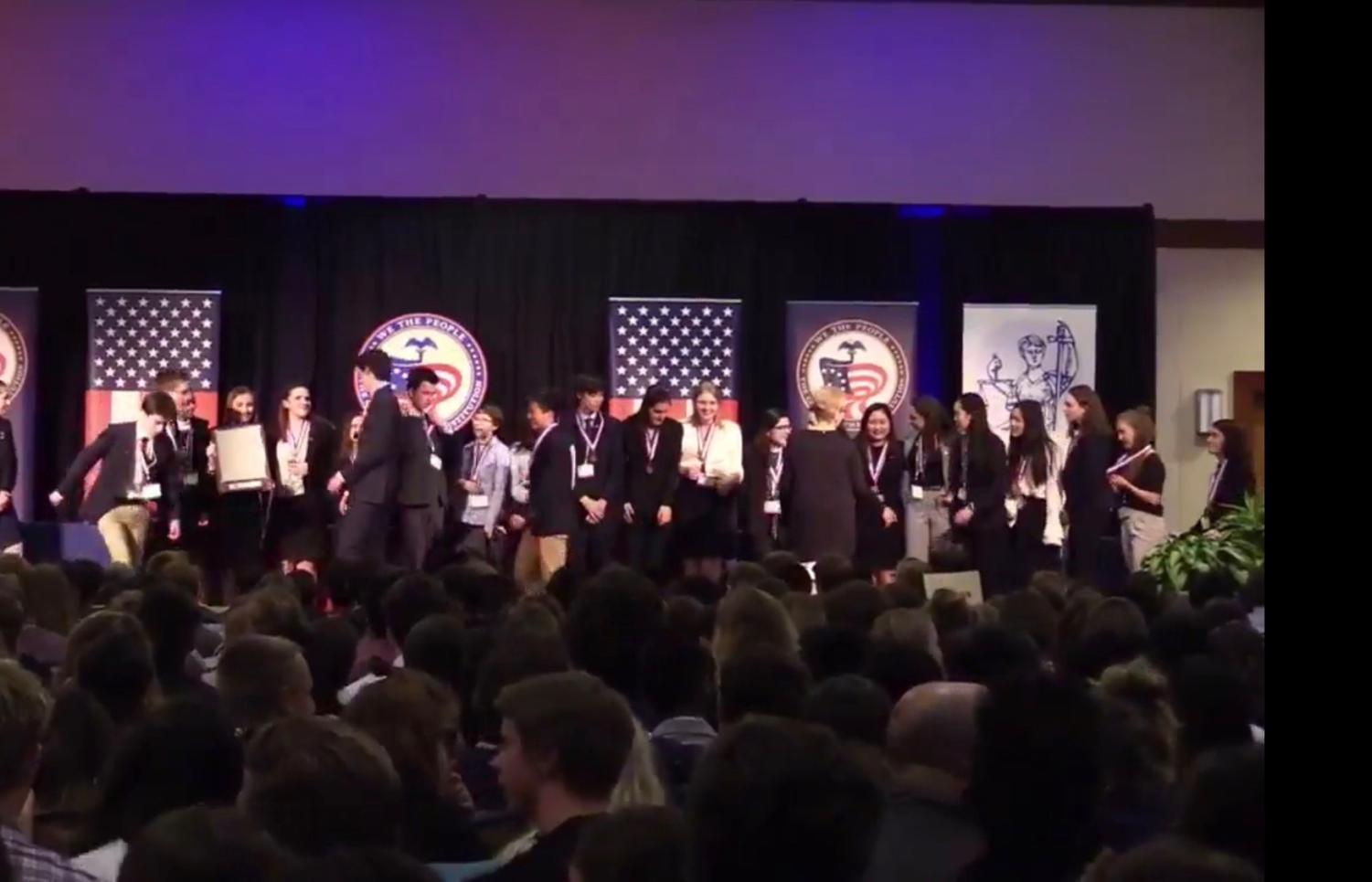 Lincoln's Con Team celebrates on stage after placing third at Nationals in Washington, D.C. on April 30.
