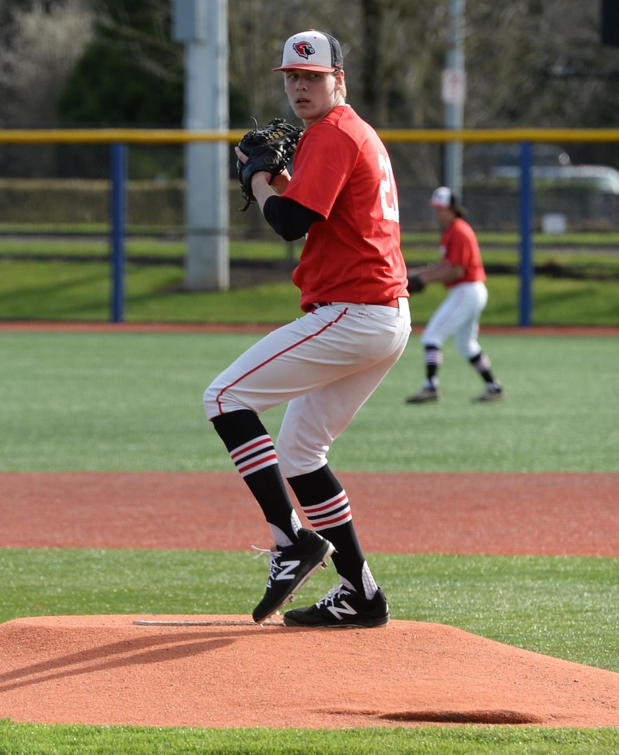 Senior Zane Mills pitches the ball during a game against Madison on April 10. Mills will play baseball for the Washington State Cougars next year.